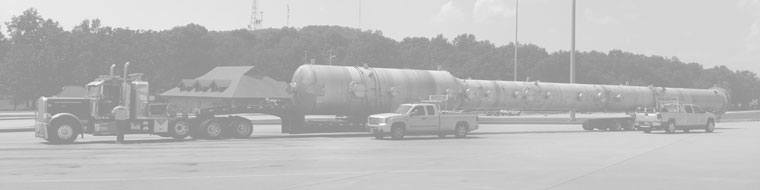 A greyed out version of an oversized load parked inside a rest area flanked by two pilot car vehicles.