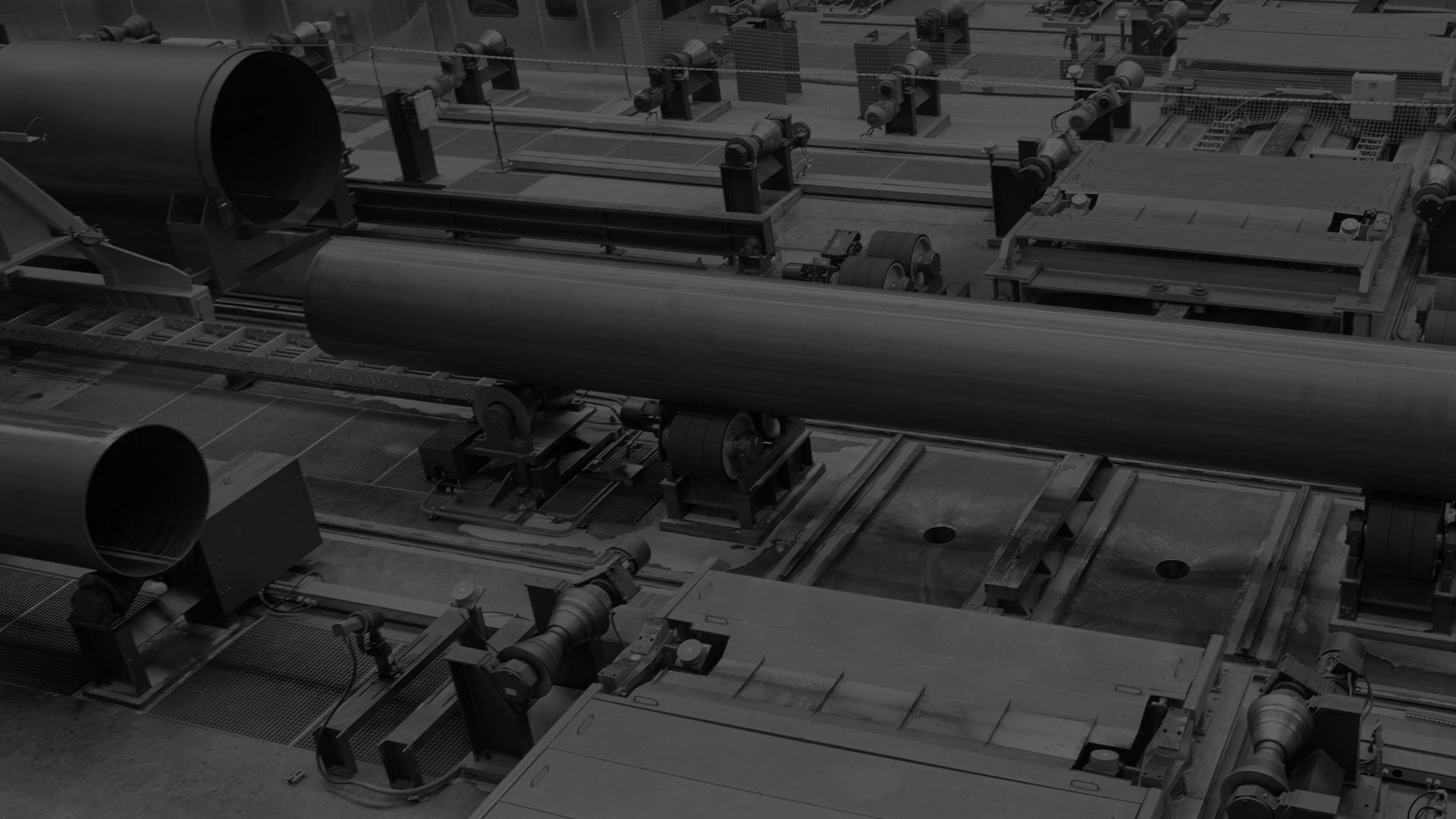 A darkened black and white image of a custom fabrication being manufacturer.