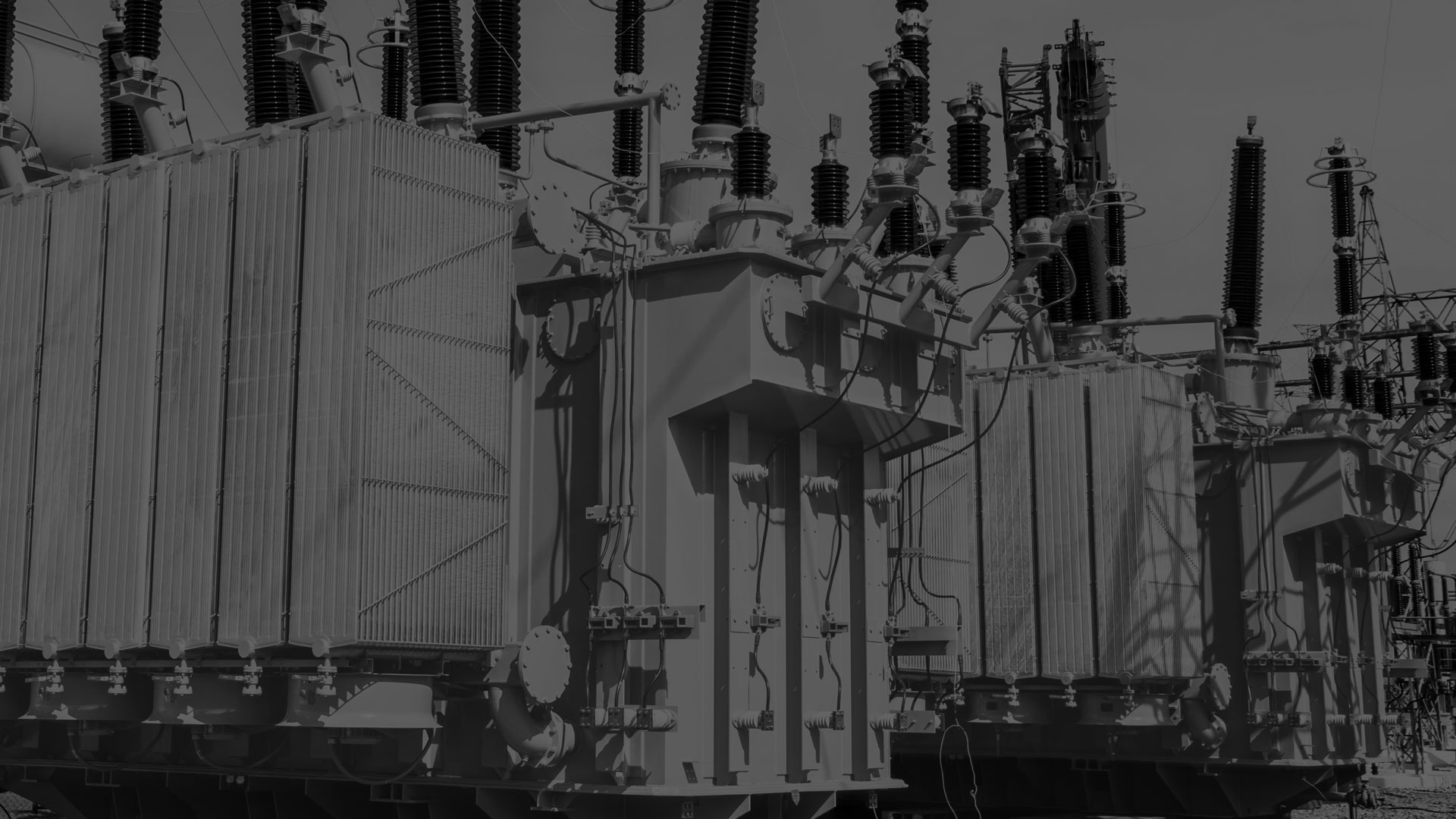 A darkened black and white image of a electrical transformer.