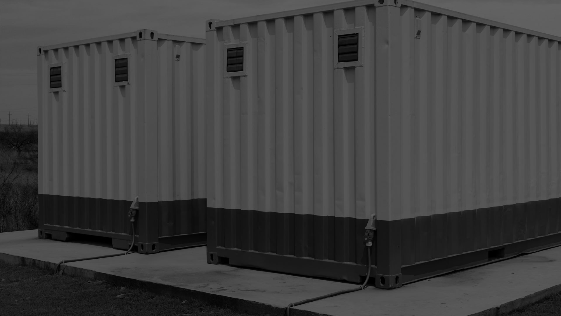 A darkened black and white image of container buildings.