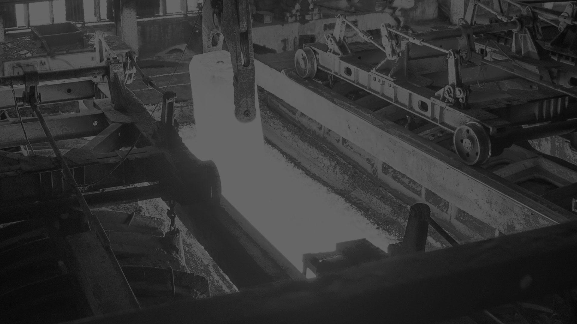 A darkened black and white image of a heat treat furnance.