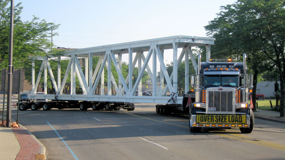 A steerable dolly making a turn with a oversize bridge section