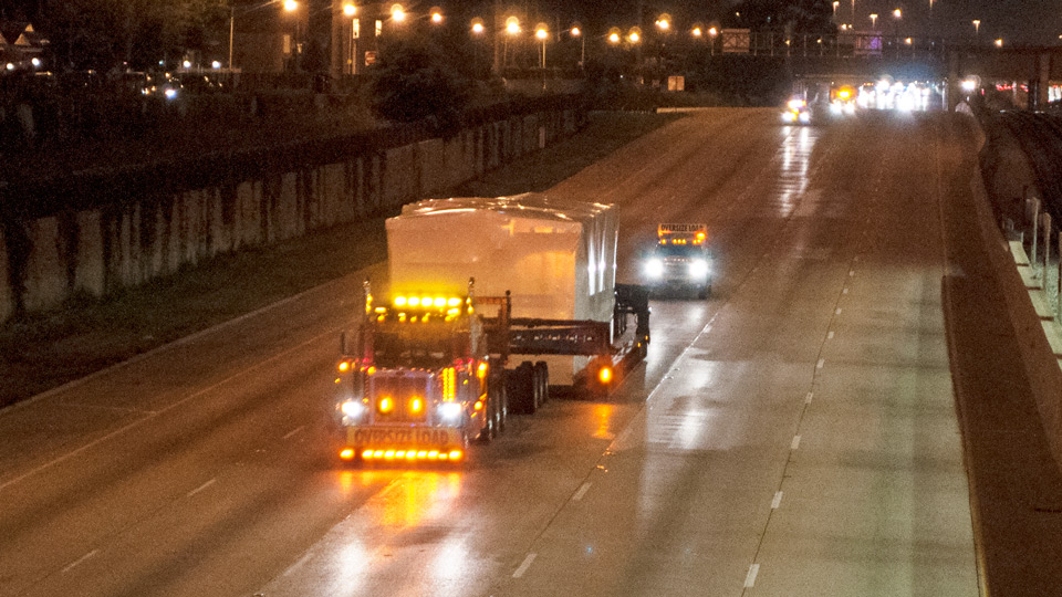 A perimeter 13 axle traveling down the interstate during the night time hours.