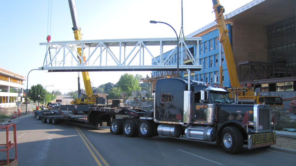 A bridge section being offloaded from a bolster and dolly setup.